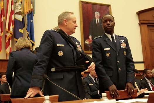 WASHINGTON, DC - January 23 - General Mark A. Welsh III, USAF, Chief of Staff, USAF at left and General Edward A. Rice, Jr., USAF, Commander, Air Education and Training Command, USAF wait for hearing to resume on review of sexual misconduct by basic training instructors at Lackland Air Force Base by House Armed Services Committee, 2118 Rayburn Building. Photo: Susan Biddle / Susan Biddle