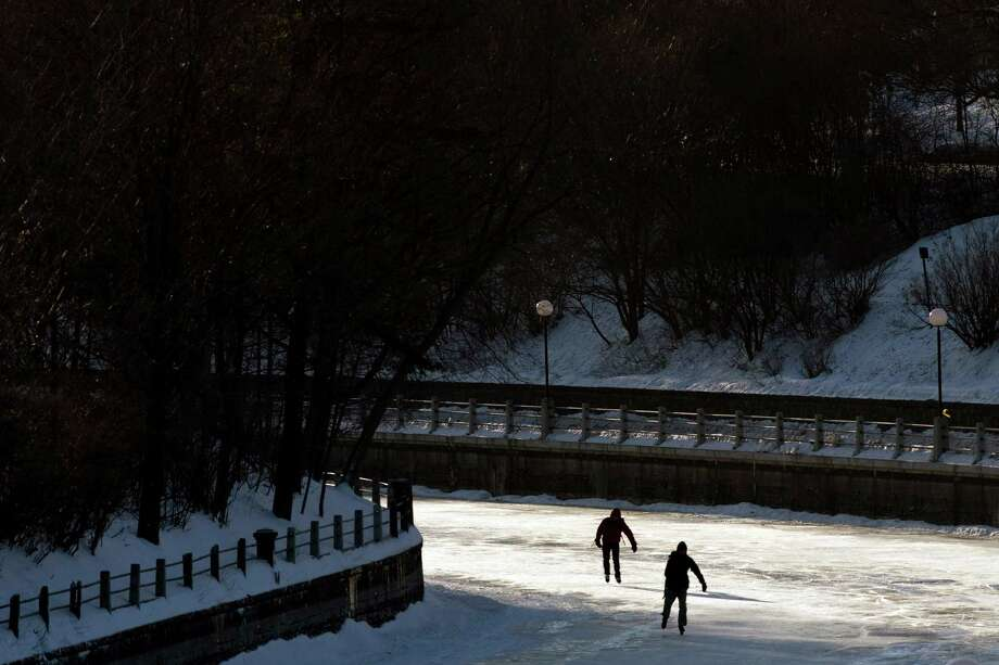 Two skaters make their way along the Rideau Canal in cold temperatures, Wednesday, Jan. 23, 2013, in Ottawa, Ontario. Photo: Adrian Wyld, Associated Press / The Canadian Press