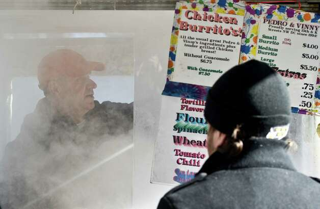 Steam pours out from a Mexican Burrito vendor's lunch wagon on a street in Washington, DC, on January 23, 2013. Two-thirds of the US was in the grips of a blast of cold Arctic air Wednesday with temperatures falling to some of the lowest marks in years and wind chills plummeting to dangerously low levels. Photo: MLADEN ANTONOV, AFP/Getty Images / AFP