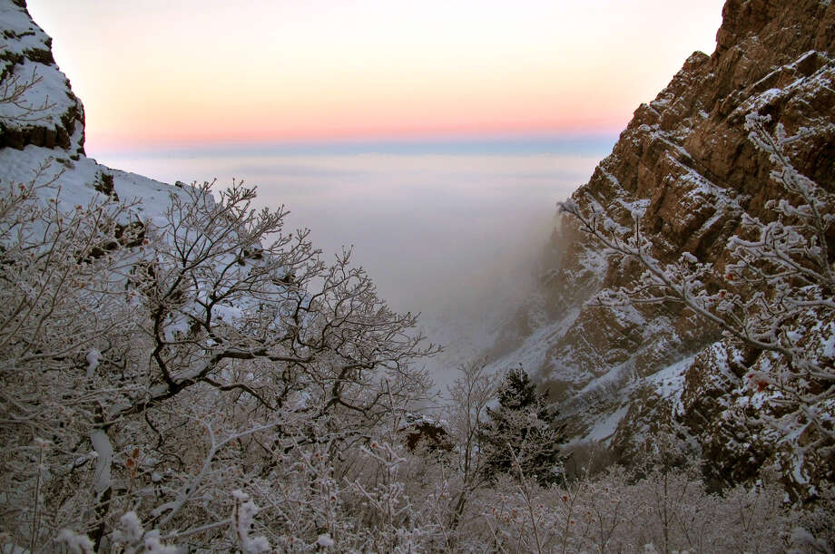 In this Tuesday, Jan. 22, 2013, photo, frost covers tree branches above an inversion cloud at sunrise in Willard Canyon in Box Elder County, Utah. Photo: Robert Johnson, Associated Press / Standard-Examiner