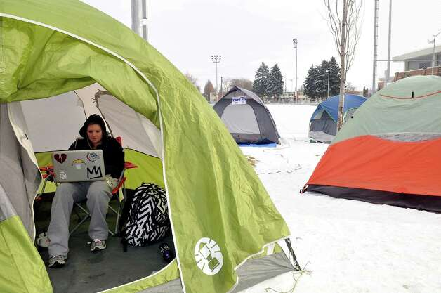 Kaitlin Ballantyne, 20, does her homework in a tent outside the McCarthey Athletic Center at Gonzaga University, in Spokane, Wash.,Wednesday, Jan. 23, 2013. Sixty-plus tents are filled with students intent on getting front row seats to Thursday's GU-BYU men's basketball game. The students, who must remain with the tents to keep their place in the ticket line, were told Tuesday night by campus police to sleep inside and return by 7 a.m. Wednesday to avoid the near single digit temperatures. Photo: Jesse Tinsley, Associated Press / The Spokesman-Review
