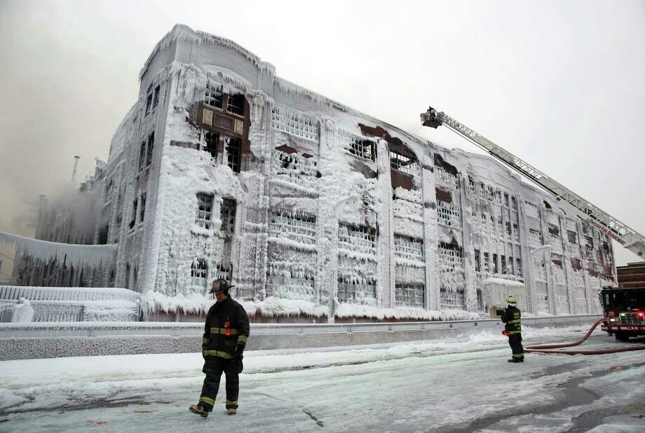 Firefighters spray hot spots remaining from an overnight fire at an abandoned warehouse in Chicago, Illinois, on Wednesday, January 23, 2013. Photo: John J. Kim, McClatchy-Tribune News Service / Chicago Tribune