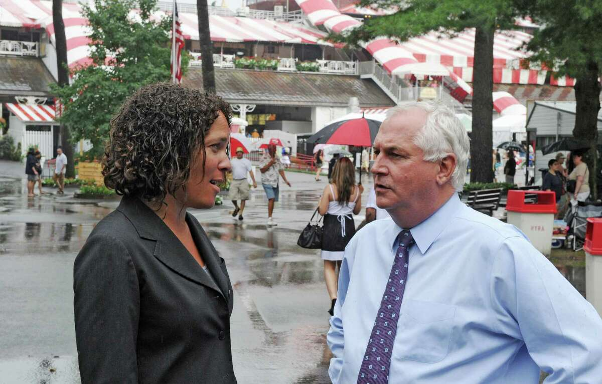 Current NYRA President and Chief Operating Officer Ellen McClain, left, speaks with the now former President and CEO, Charles Hayward, right, at Saratoga Race Course Aug. 8, 2011, in Saratoga Springs, N.Y. (Skip Dickstein / Times Union archive)
