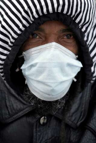 Terry Tauriac wears a mask to protect his face on a cold winter day in Buffalo, N.Y., Wednesday, Jan. 23, 2013.   A teeth-chattering cold wave with sub-zero temperatures was expected to keep its icy grip on much of the eastern U.S. into the weekend before seasonable temperatures bring relief. Photo: David Duprey, Associated Press / AP