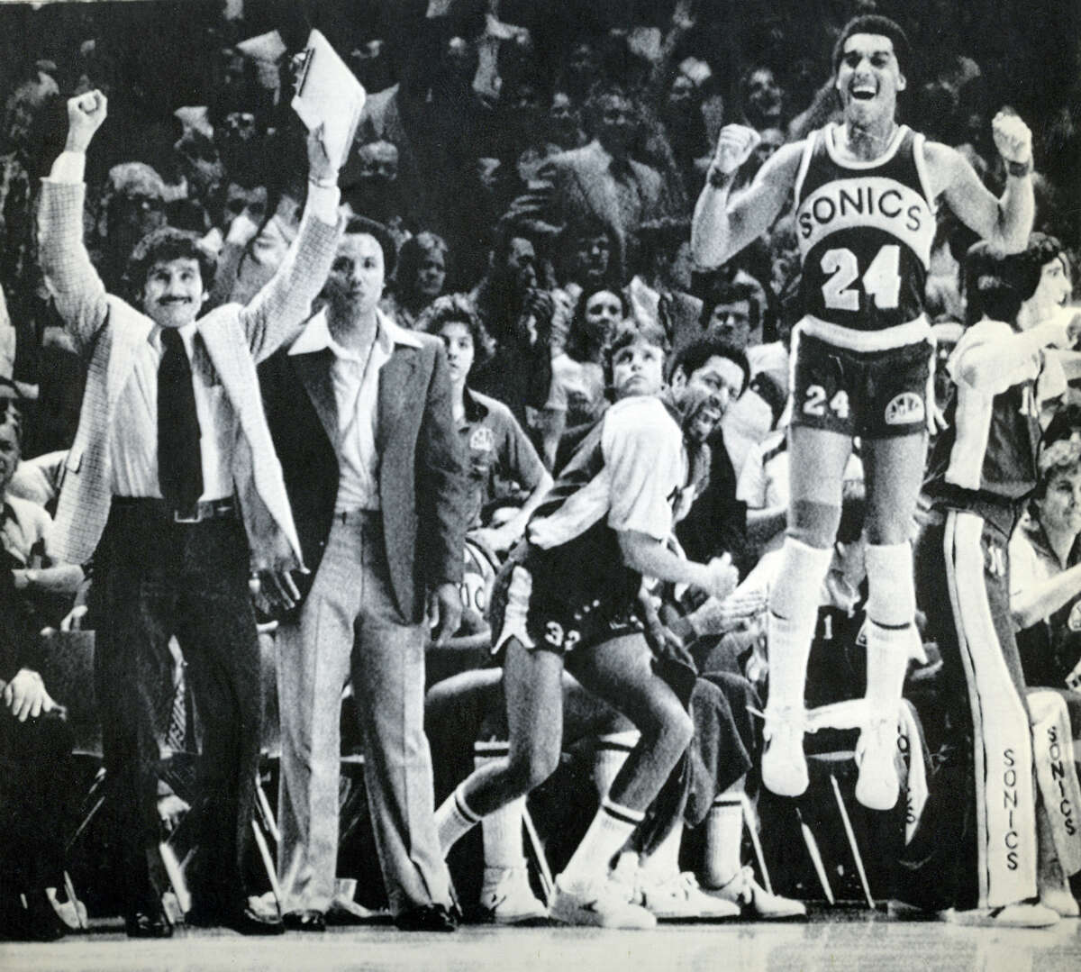 From left to right: SuperSonics assistant coach Les Habegger, head coach Lenny Wilkens, team captain Fred Brown and player Dennis Johnson celebrate as their 1979 championship win over the Washington Bullets nears.
