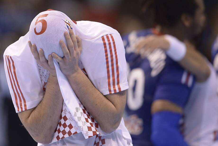 Croatia's Domagoj Duvnjak covers his face as he reacts after his team took victory over France during the 23rd Men's Handball World Championships quarterfinal match at the Pabellon Principe Felipe in Zaragoza, Spain, Wednesday, Jan. 23, 2013. Photo: Manu Fernandez, Associated Press