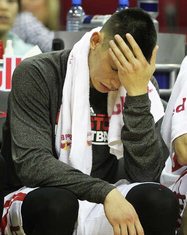 Rockets point guard Jeremy Lin (7) wipes the sweat from his face as his game against the Nuggets comes to an end. Photo: Nick De La Torre, Houston Chronicle / © 2013  Houston Chronicle