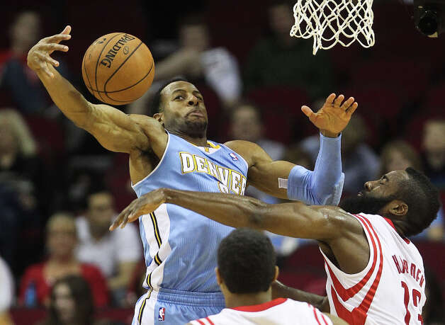 Nuggets shooting guard Andre Iguodala (9) tries to gather the ball after Rockets shooting guard James Harden (13) broke up his drive. Photo: Nick De La Torre, Houston Chronicle / © 2013  Houston Chronicle
