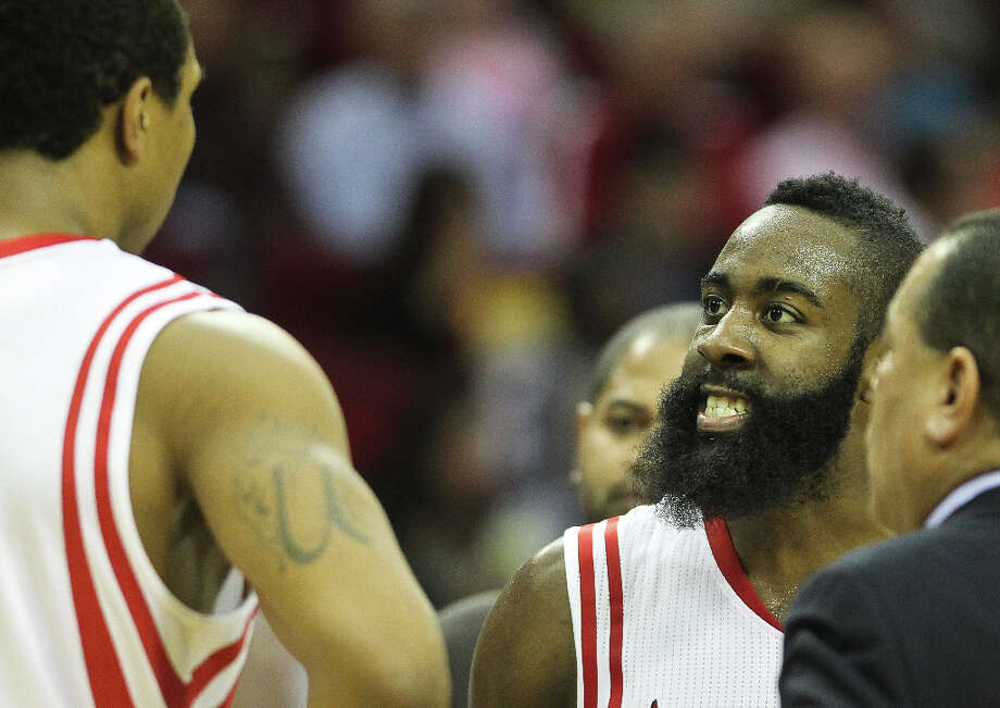 Rockets shooting guard James Harden (13) gets angry with power forward Greg Smith (4) during a time out. Photo: Nick De La Torre, Houston Chronicle / © 2013  Houston Chronicle