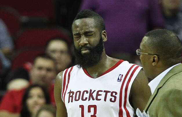 A shaky James Harden (13) returns to the bench after hurting his eye during the second quarter. Photo: Nick De La Torre, Houston Chronicle / © 2013  Houston Chronicle