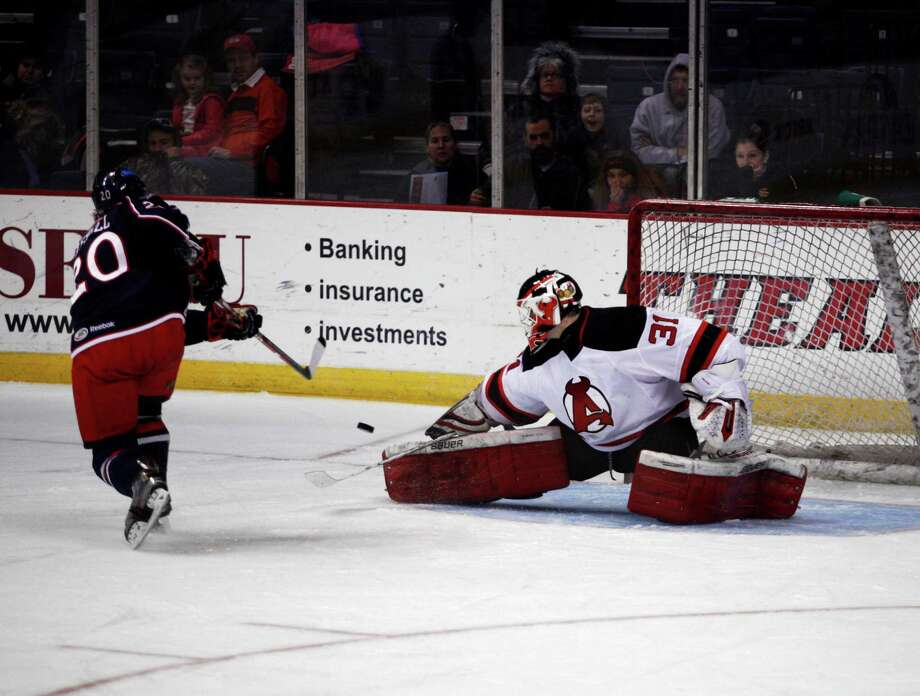 Albany Devil's goalie Jeff Frazee (31) saves a penalty shot from Springfield Falcons Ryan Russell (20) during the second period, Wednesday evening, Jan. 23, 2013, at the Times Union Center in Albany, N.Y. (Dan Little/Special to the Times Union). Photo: Dan Little / Dan Little
