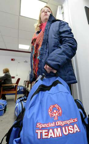 Emily Stephen holds her travel bag at the Special Olympics headquarters in Niskayuna, N.Y. as she prepares to leave for the Special Olympics World Winter Games Jan. 23, 2013,  in South Korea and will compete in Alpine Skiing.    (Skip Dickstein/Times Union) Photo: SKIP DICKSTEIN / 00020879A