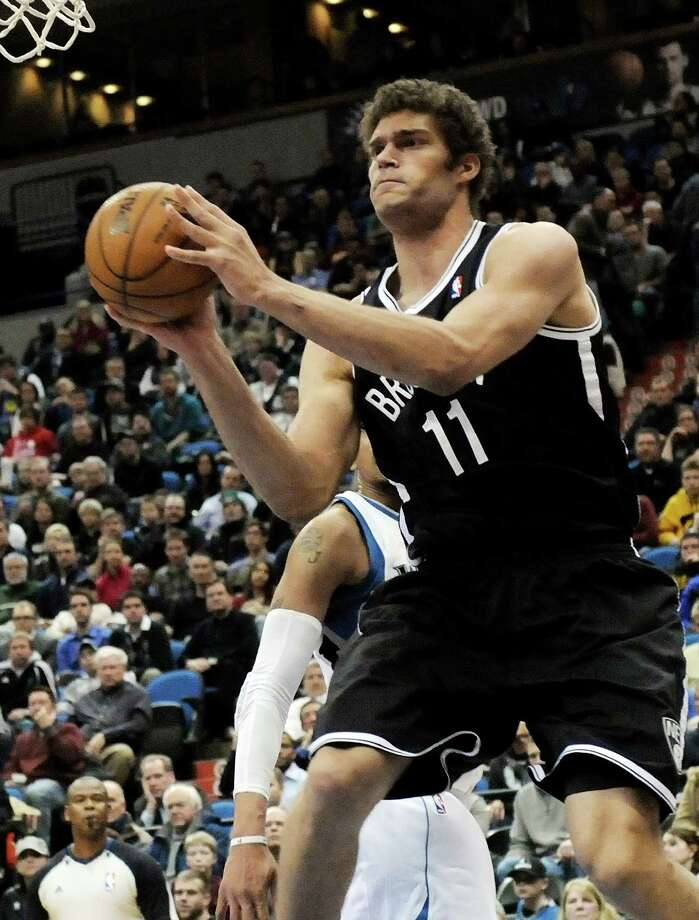 Brooklyn Nets' Brook Lopez looks to pass in the second half of an NBA basketball game against the Minnesota Timberwolves, Wednesday, Jan. 23, 2013, in Minneapolis.  Lopez led the the Nets with 22 points and 7 rebounds in their 91-83 win. (AP Photo/Jim Mone) Photo: Jim Mone