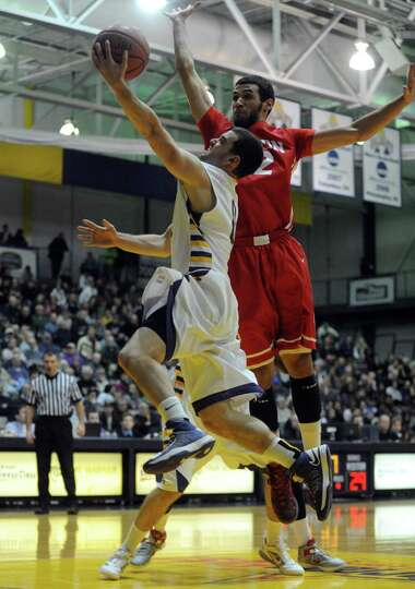 UAlbany's Jacob Iati goes to the basket during their men's college basketball game against Boston Un