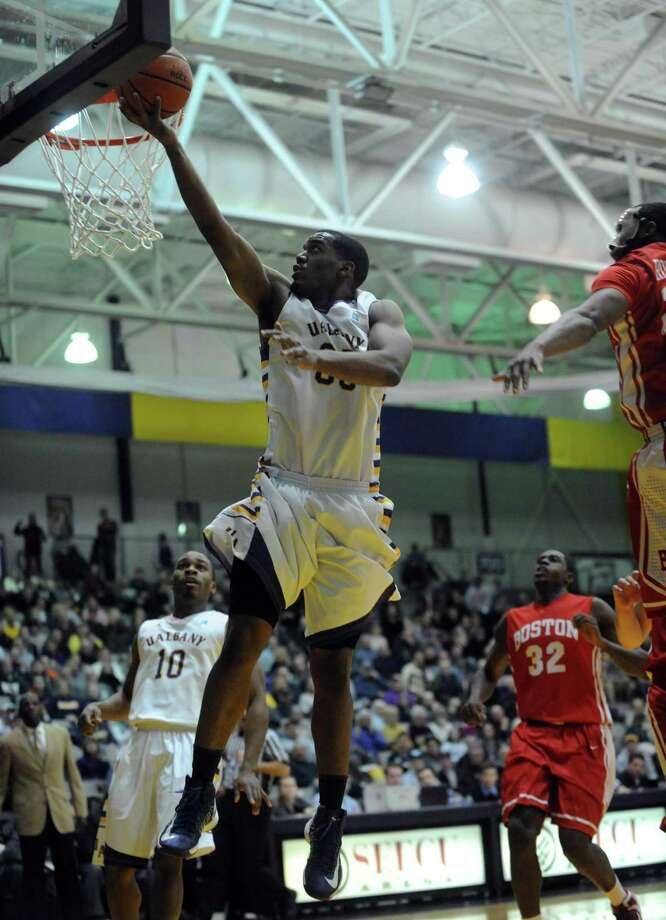 UAlbany's Jayson Guerrier goes to the basket during their men's college basketball game against Boston University at the SEFCU Arena on Wednesday Jan. 23,2013 in Albany, N.Y. (Michael P. Farrell/Times Union) Photo: Michael P. Farrell