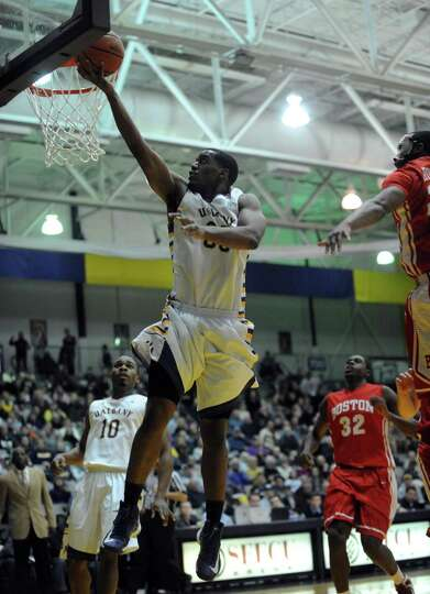 UAlbany's Jayson Guerrier goes to the basket during their men's college basketball game against Bost