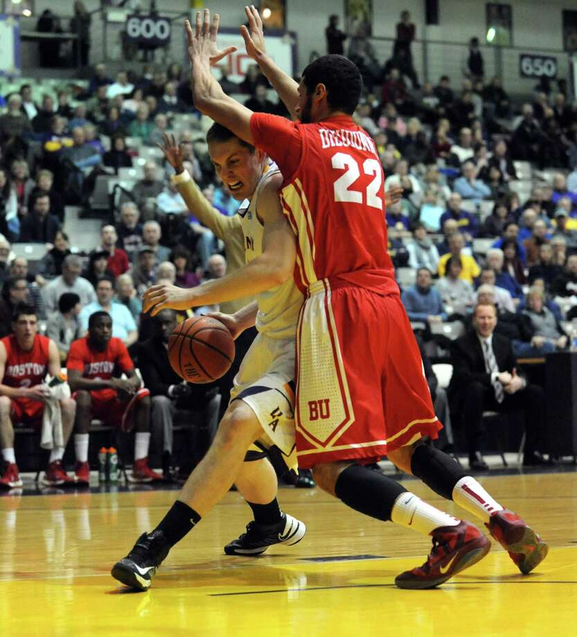UAlbany's Luke Devlin drives to the basket during their men's college basketball game against Boston University at the SEFCU Arena on Wednesday Jan. 23,2013 in Albany, N.Y. (Michael P. Farrell/Times Union) Photo: Michael P. Farrell
