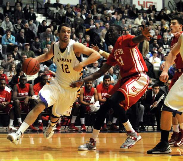 UAlbany's Peter Hooley drives to the basket during their men's college basketball game against Bosto