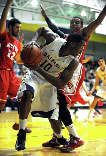 UAlbany's Mike Black looks for an open teammate during their men's college basketball game against B