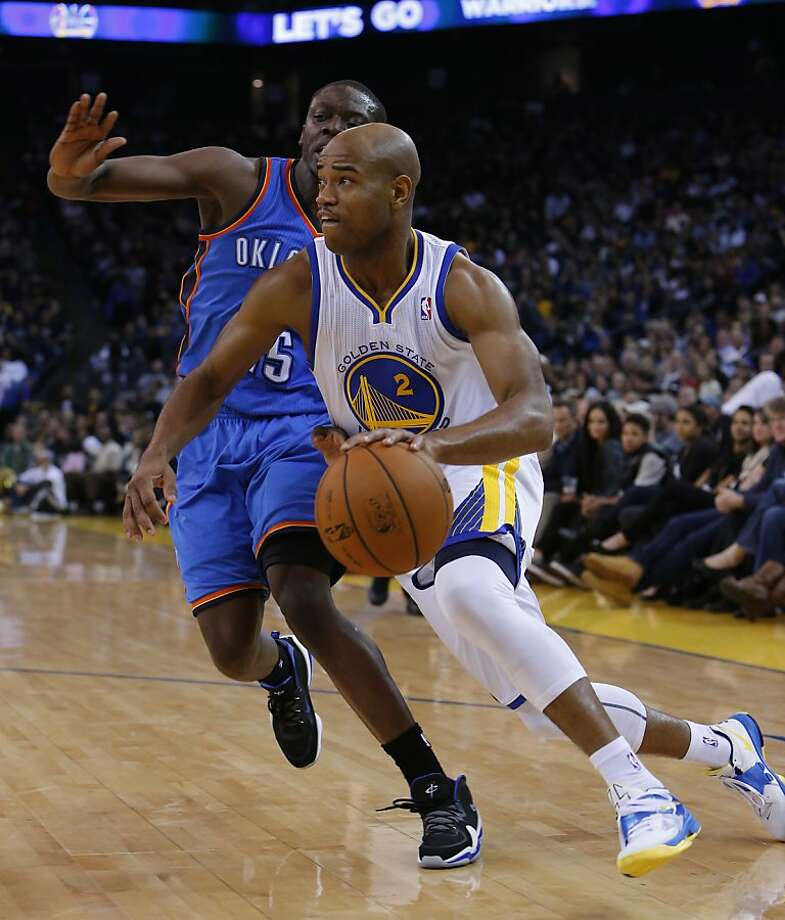 Jarrett Jack drives past Reggie Jackson in the first half. The Golden State Warriors played the Oklahoma City Thunder at Oracle Arena in Oakland, Calif., on Wednesday, January 23, 2013. Photo: Carlos Avila Gonzalez, The Chronicle
