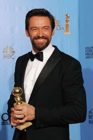Hugh Jackman in 2013, with his Best Actor Golden Globe award. He's been nominated for an Academy Award for his movie 'Les Miserables.' Photo: Kevin Winter, Getty Images / 2013 Getty Images