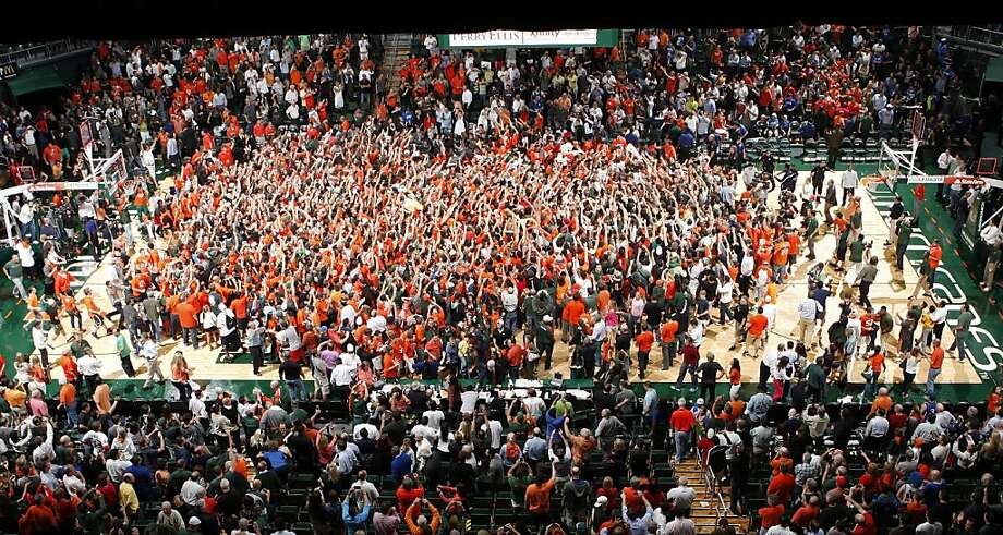 Fans storm the court after the Miami Hurricanes defeated the Duke Blue Devils on January 23, 2013 at the BankUnited Center in Coral Gables, Florida. Miami defeated Duke 90-63. Photo: Joel Auerbach, Getty Images