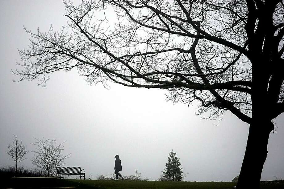 In this Tuesday, Jan. 22, 2013 photo, a dense fog hangs over Lions Park in Bremerton, Wash. Photo: Larry Steagall, Associated Press