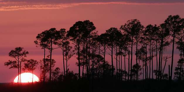 The sun sets along the coast near Alabama Port, Ala., Wednesday, Jan. 23, 2013. Partly cloudy skies and moderate temperatures are forecast for the next few days, bringing with it the opportunity to colorful sunsets. Photo: Dave Martin, Associated Press