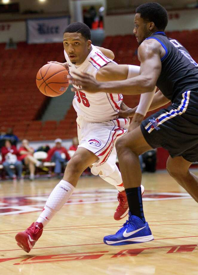 The University of Houston's TaShawn Thomas drives past Tulsa's James Woodard, right, in the first half as the University of Houston played the University of Tulsa at Hofheinz Pavilion Wednesday, Jan. 23, 2013, in Houston. Photo: Johnny Hanson, Houston Chronicle / © 2013  Houston Chronicle