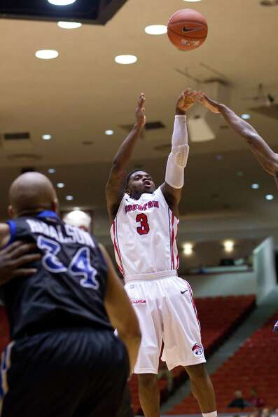 The University of Houston's J.J. Thompson puts up a shot in the first half as the University of Hous
