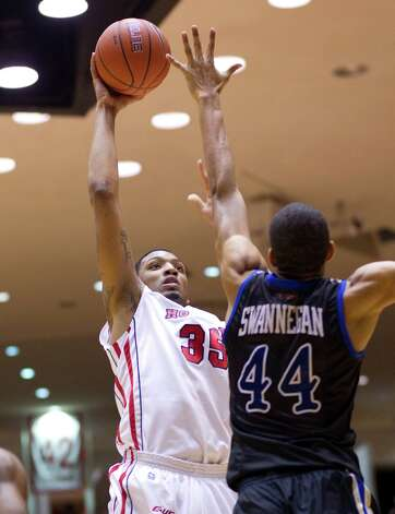 The University of Houston's TaShawn Thomas (35) puts up a shot over Tulsa's Brandon Swannegan (44) in the first half as the University of Houston played the University of Tulsa at Hofheinz Pavilion Wednesday, Jan. 23, 2013, in Houston. Photo: Johnny Hanson, Houston Chronicle / © 2013  Houston Chronicle