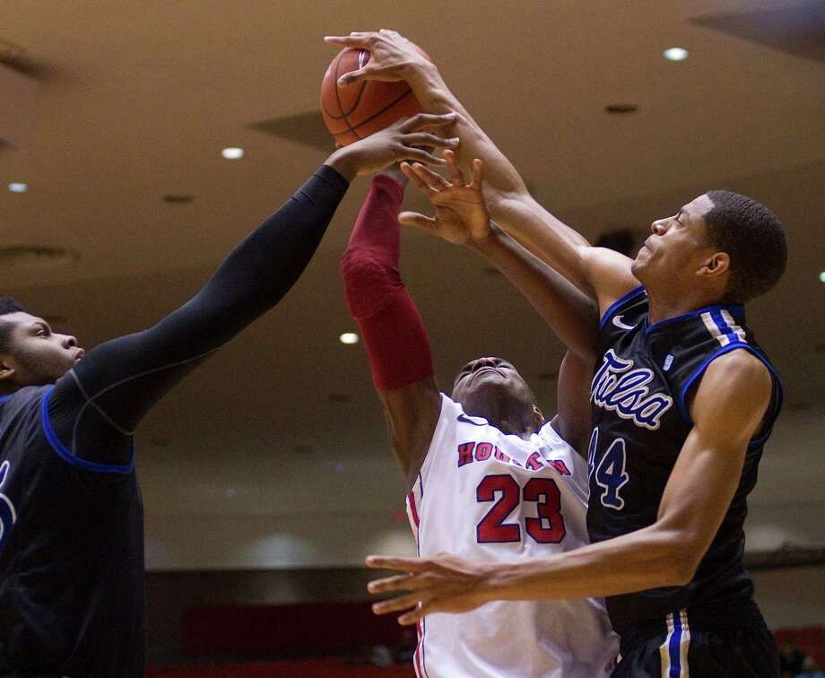 The University of Houston's Danuel House is fouled going up for a basket against Brandon Swannegan, right, and Zeldric King, left, in the first half as the University of Houston played the University of Tulsa at Hofheinz Pavilion Wednesday, Jan. 23, 2013, in Houston. Photo: Johnny Hanson, Houston Chronicle / © 2013  Houston Chronicle