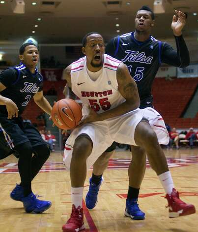 The University of Houston's J.J. Richardson drives past Tulsa's Pat Swilling, Jr., left, and  Zeldric King, right, in the first half as the University of Houston played the University of Tulsa at Hofheinz Pavilion Wednesday, Jan. 23, 2013, in Houston. Photo: Johnny Hanson, Houston Chronicle / © 2013  Houston Chronicle