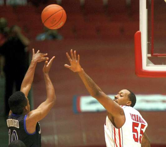 Tulsa's James Woodard puts up a shot over the University of Houston's J.J. Richardson in the first half as the University of Houston played the University of Tulsa at Hofheinz Pavilion Wednesday, Jan. 23, 2013, in Houston. Photo: Johnny Hanson, Houston Chronicle / © 2013  Houston Chronicle