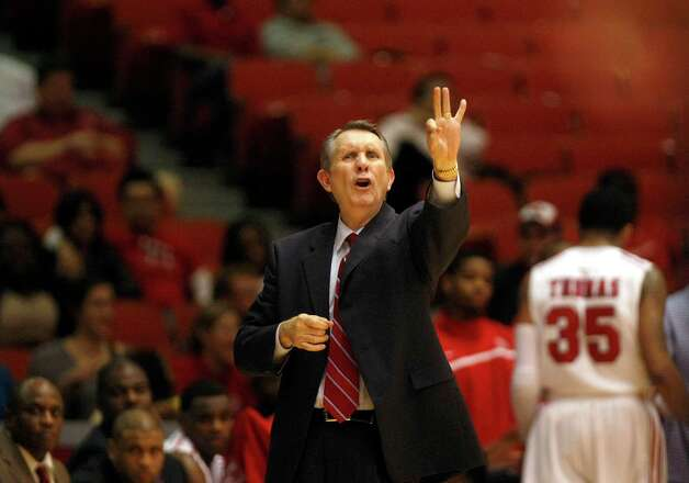 University of Houston coach James Dickey calls a play in the first half as the University of Houston played the University of Tulsa at Hofheinz Pavilion Wednesday, Jan. 23, 2013, in Houston. Photo: Johnny Hanson, Houston Chronicle / © 2013  Houston Chronicle