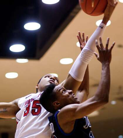 The University of Houston's TaShawn Thomas puts up a shot over Tulsa's Zeldric King in the first half as the University of Houston played the University of Tulsa at Hofheinz Pavilion Wednesday, Jan. 23, 2013, in Houston. Photo: Johnny Hanson, Houston Chronicle / © 2013  Houston Chronicle