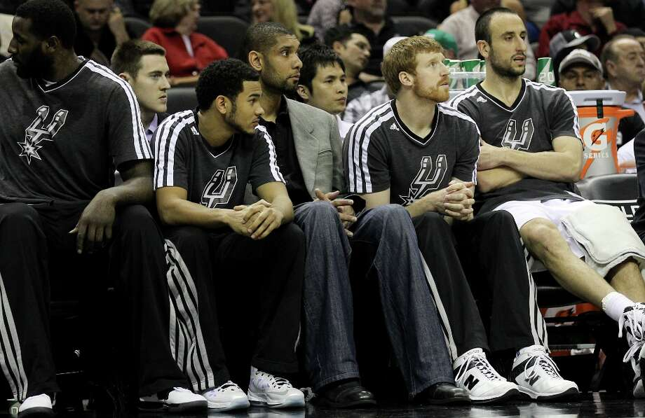 Spurs' Tim Duncan did not suit up for the game against the New Orleans Hornets on Wednesday, Jan. 23, 2013. Duncan sat out with a sore left knee. Photo: Kin Man Hui, San Antonio Express-News / © 2012 San Antonio Express-News