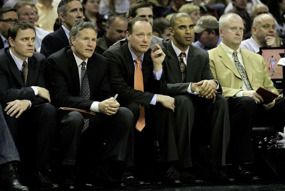 Spurs assistant coach Mike Budenholzer (center) takes the head coaching reigns against the New Orleans Hornets on Wednesday, Jan. 23, 2013. Photo: Kin Man Hui, San Antonio Express-News / © 2012 San Antonio Express-News