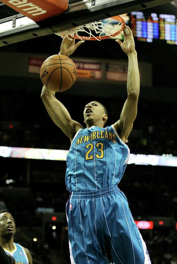 New Orleans Hornets' Anthony Davis (23) dunks against the Spurs in the first half on Wednesday, Jan. 23, 2013. Photo: Kin Man Hui, San Antonio Express-News / © 2012 San Antonio Express-News