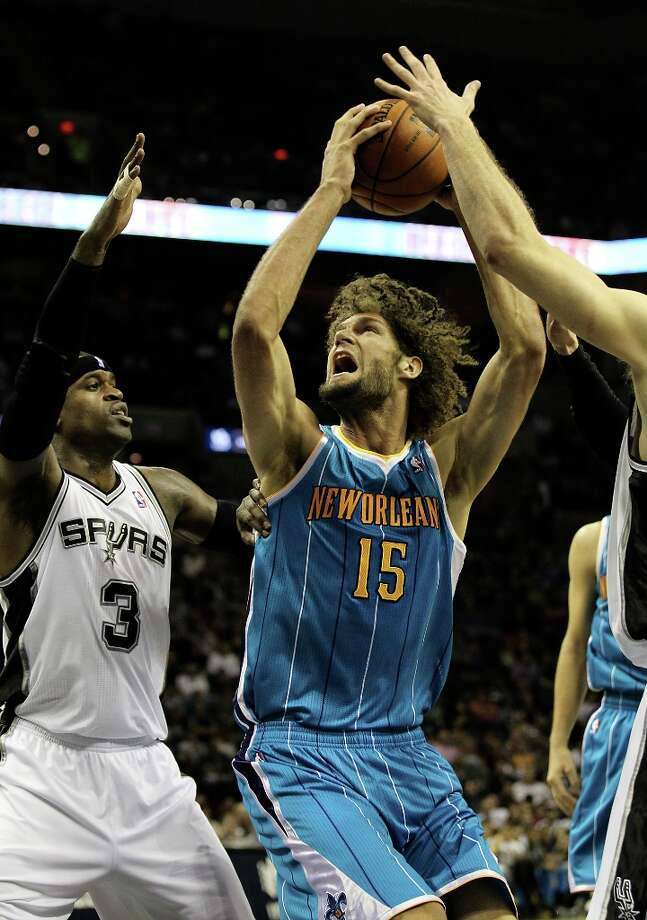 Spurs' Stephen Jackson (03) defends the paint against New Orleans Hornets' Robin Lopez (15) in the first half on Wednesday, Jan. 23, 2013. Photo: Kin Man Hui, San Antonio Express-News / © 2012 San Antonio Express-News