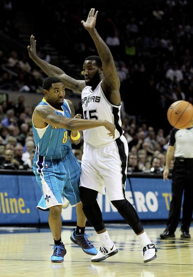 Spurs' DeJuan Blair (45) defends against New Orleans Hornets' Roger Mason Jr. (08) in the first half on Wednesday, Jan. 23, 2013. Photo: Kin Man Hui, San Antonio Express-News / © 2012 San Antonio Express-News