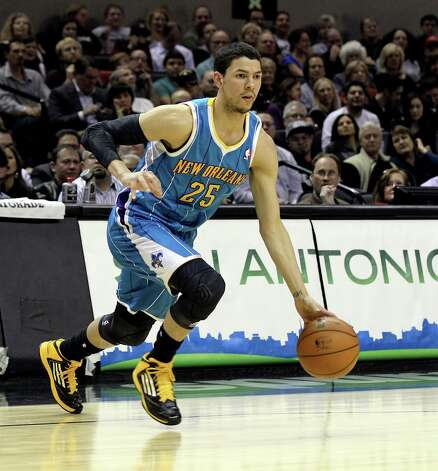 New Orleans Hornets' Austin Rivers (25) drives to the bakset against the Spurs in the first half on Wednesday, Jan. 23, 2013. Rivers is the son of Boston Celtics head coach Glenn Doc Rivers. Photo: Kin Man Hui, San Antonio Express-News / © 2012 San Antonio Express-News