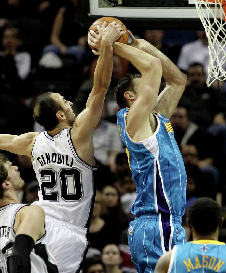 Spurs' Manu Ginobili (20) makes a block against New Orleans Hornets' Jason Smith (14) in the second half on Wednesday, Jan. 23, 2013. Spurs defeated the Hornets, 106-102. Photo: Kin Man Hui, San Antonio Express-News / © 2012 San Antonio Express-News