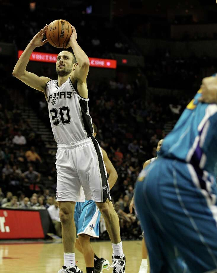 Spurs' Manu Ginobili (20) takes an open shot against the New Orleans Hornets in the second half on Wednesday, Jan. 23, 2013. Spurs defeated the Hornets, 106-102. Photo: Kin Man Hui, San Antonio Express-News / © 2012 San Antonio Express-News