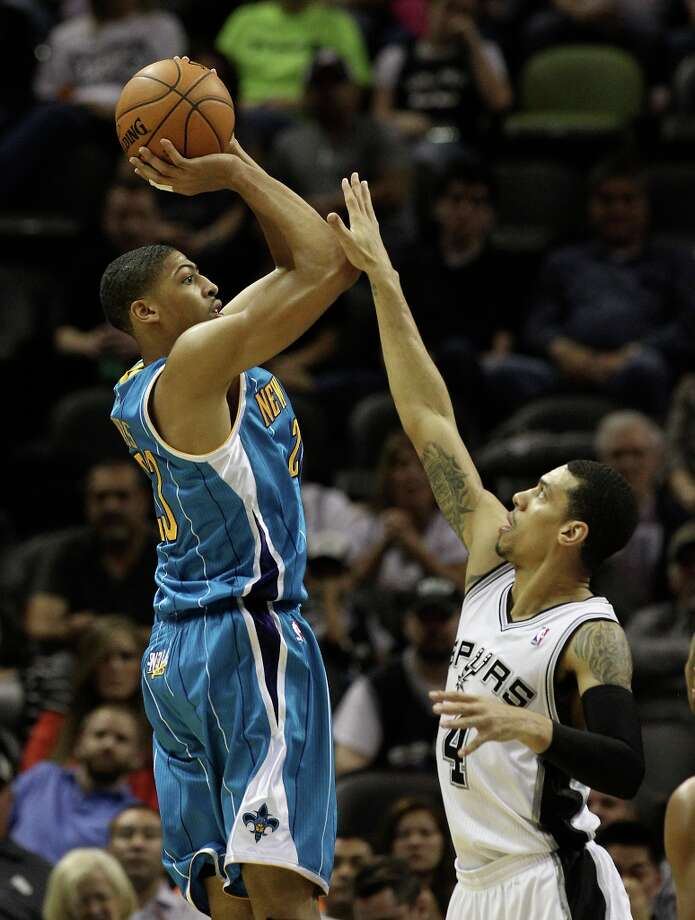 Spurs' Danny Green (04) defends against New Orleans Hornets' Anthony Davis (23) in the second half on Wednesday, Jan. 23, 2013. Spurs defeated the Hornets, 106-102. Photo: Kin Man Hui, San Antonio Express-News / © 2012 San Antonio Express-News