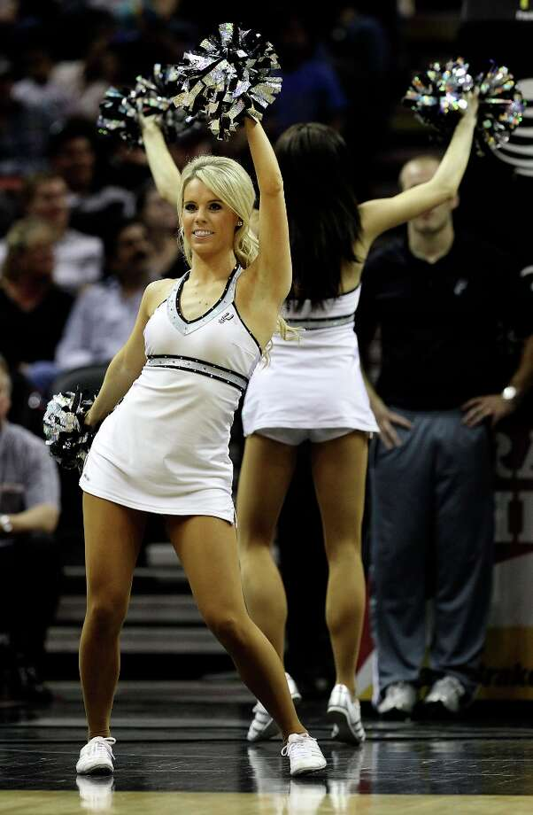 The Spurs Silverdancers perform during a timeout in a game against the New Orleans Hornets in the second half on Wednesday, Jan. 23, 2013. Spurs defeated the Hornets, 106-102. Photo: Kin Man Hui, San Antonio Express-News / © 2012 San Antonio Express-News