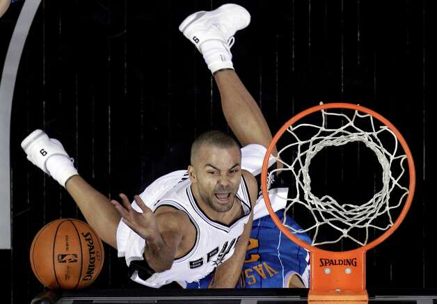 San Antonio Spurs' Tony Parker, of France, scores over New Orleans Hornets' Greivis Vasquez, obscured, during the first quarter of an NBA basketball game, Wednesday, Jan. 23, 2013, in San Antonio. Photo: Eric Gay, Associated Press / AP