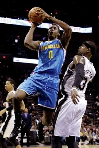 New Orleans Hornets' Al-Farouq Aminu (0) shoots over San Antonio Spurs' Stephen Jackson (3) during the first quarter of an NBA basketball game, Wednesday, Jan. 23, 2013, in San Antonio. Photo: Eric Gay, Associated Press / AP