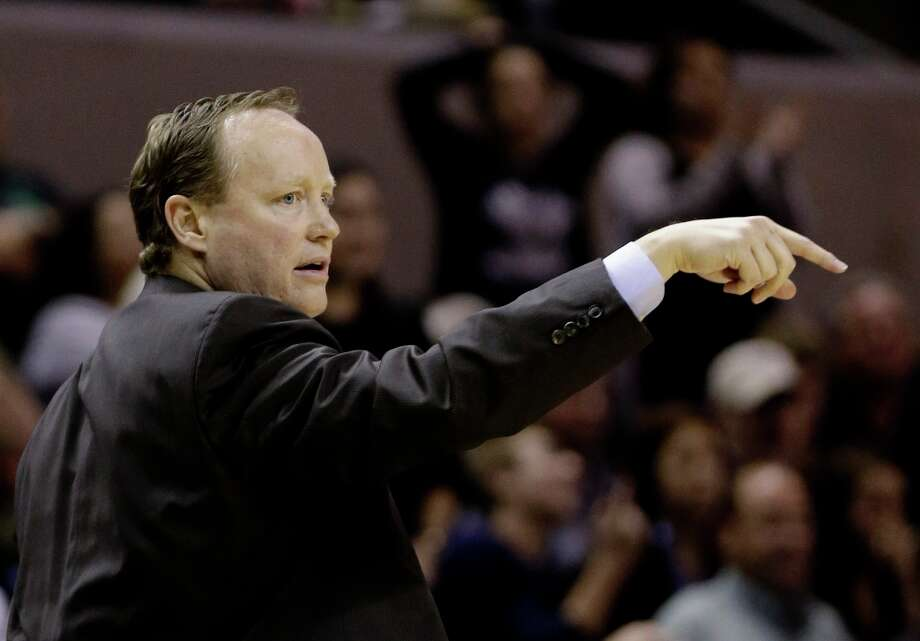 In the absence of head coach Gregg Popovich, San Antonio Spurs assistant coach Mike Budenholzer coaches the team during the fourth quarter of an NBA basketball game against the New Orleans Hornets, Wednesday, Jan. 23, 2013, in San Antonio. Photo: Eric Gay, Associated Press / AP