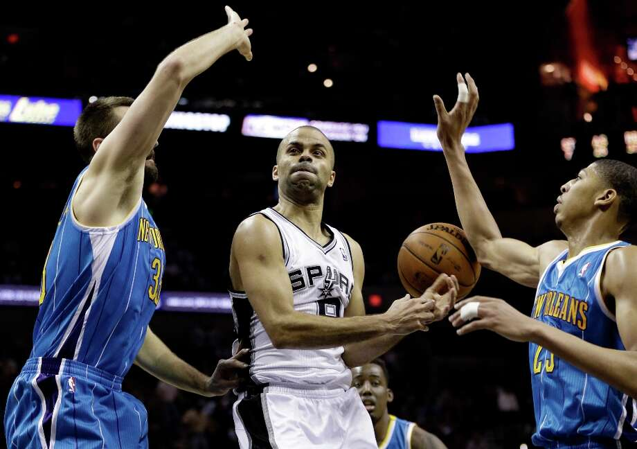 San Antonio Spurs' Tony Parker, center, of France, loses control of the ball as New Orleans Hornets' Anthony Davis, right, and New Orleans Hornets' Ryan Anderson, left, defend during the fourth quarter of an NBA basketball game, Wednesday, Jan. 23, 2013, in San Antonio. Photo: Eric Gay, Associated Press / AP